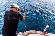 Rybář, prut, moře
